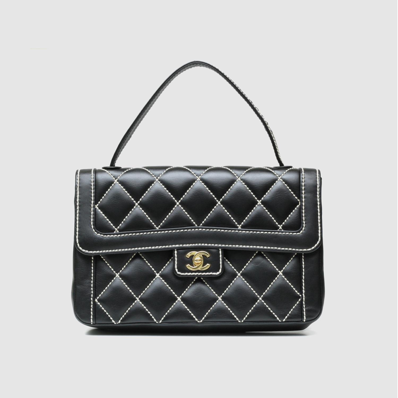 13ccb2fa8d42 Chanel Surpique Stitched Flap Handbag // Quilted Black Calfskin ...
