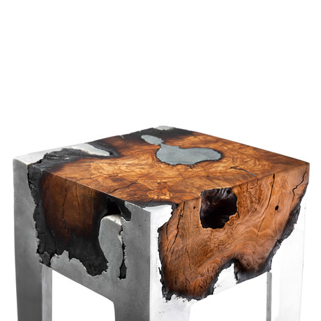 Hilla shamia cast metal burnt wood furniture touch for Burned wood furniture