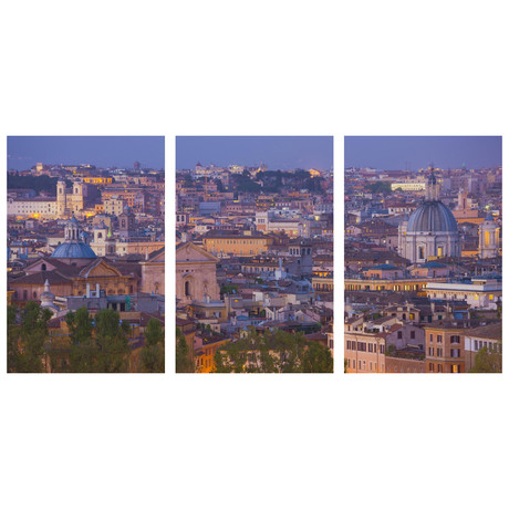 view of the historic center of rome at night triptych