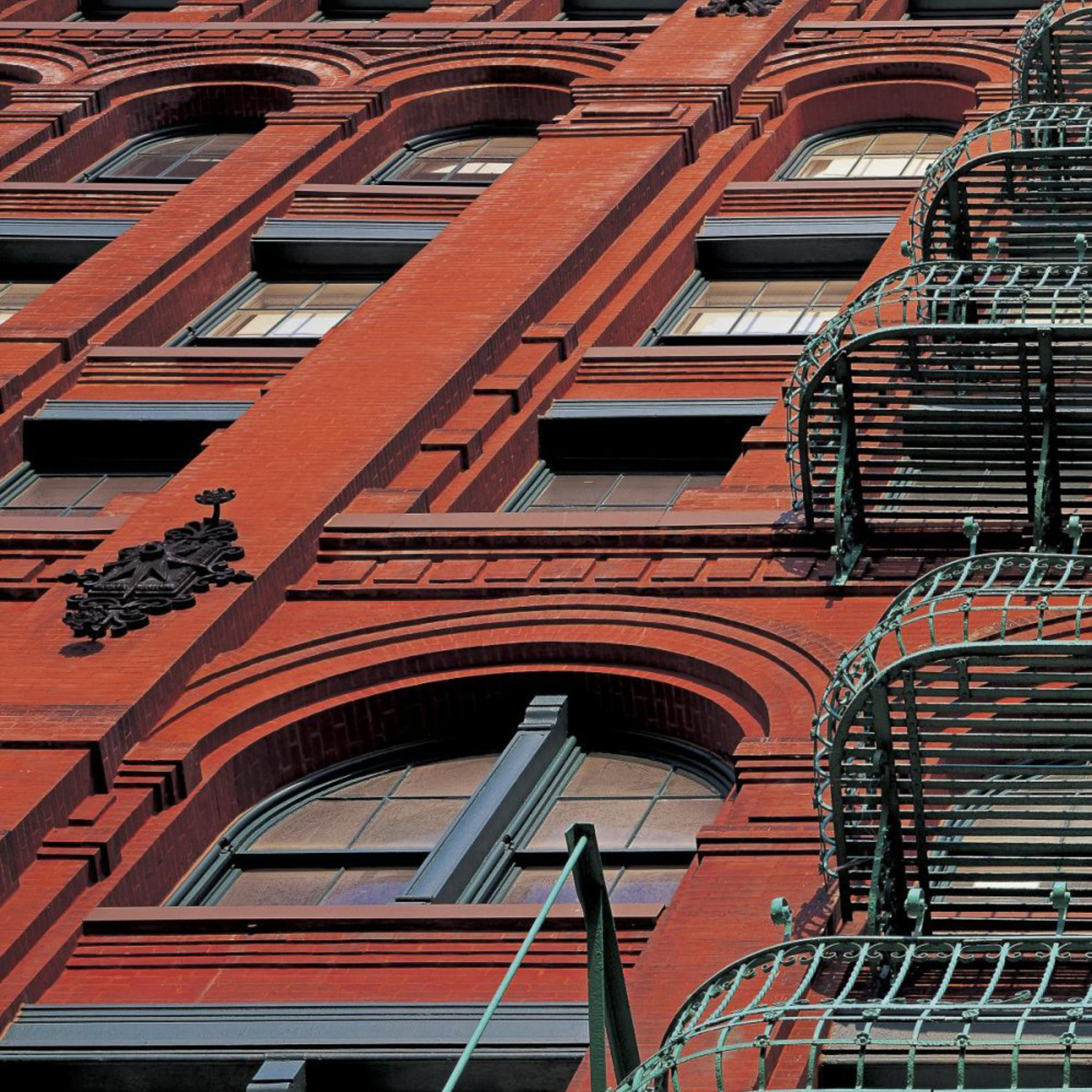 The puck building facade soho nyc triptych global for Puck building