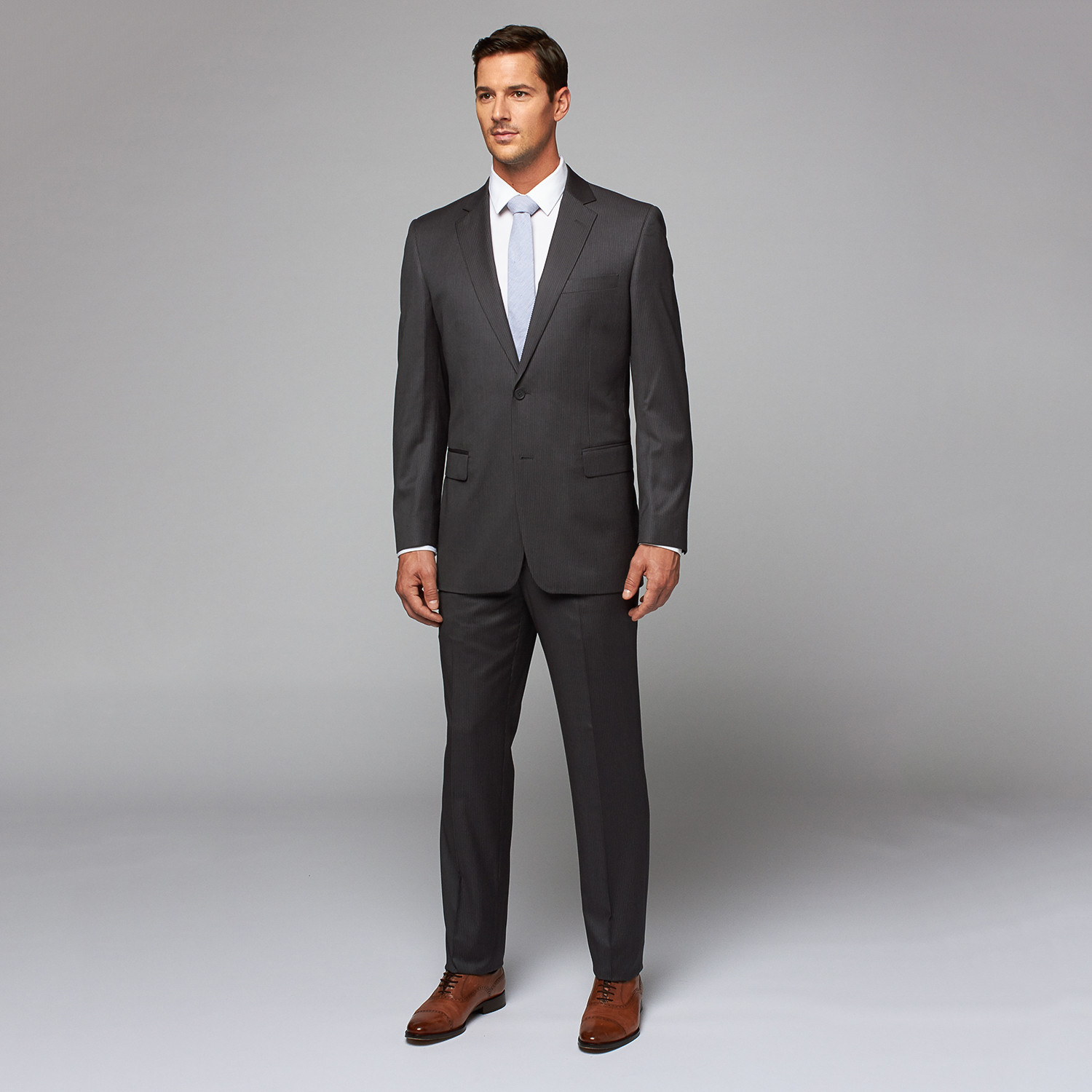 I wear a 34R and the only place I can buy suits that fit me is H&M. H&M carries 34R in most of their suits. Even though you are a 28 waist, the size 30 pants at H&M will fit correctly. H&M is a more European cut so it's the only store I can wear size