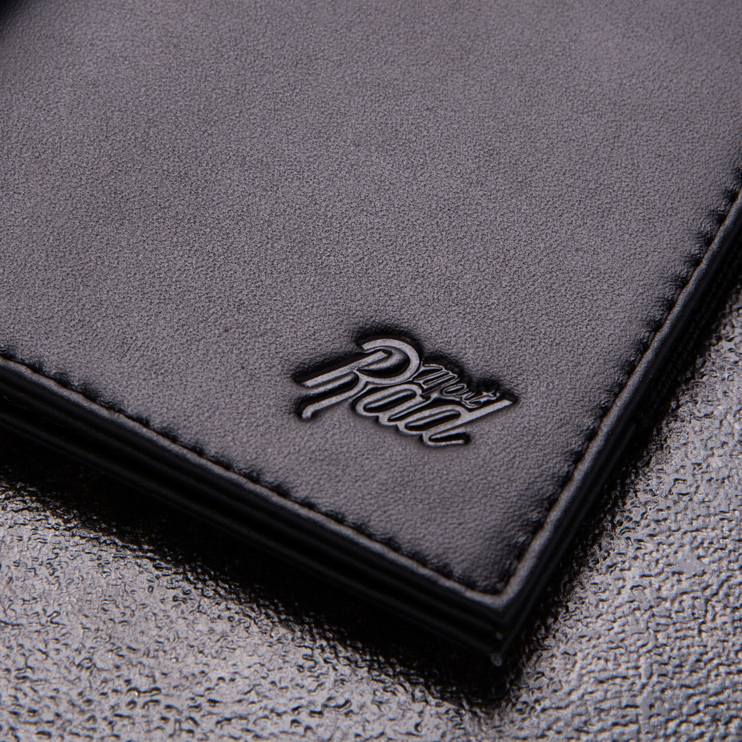 minimalist wallet black embossed logo most rad touch of modern