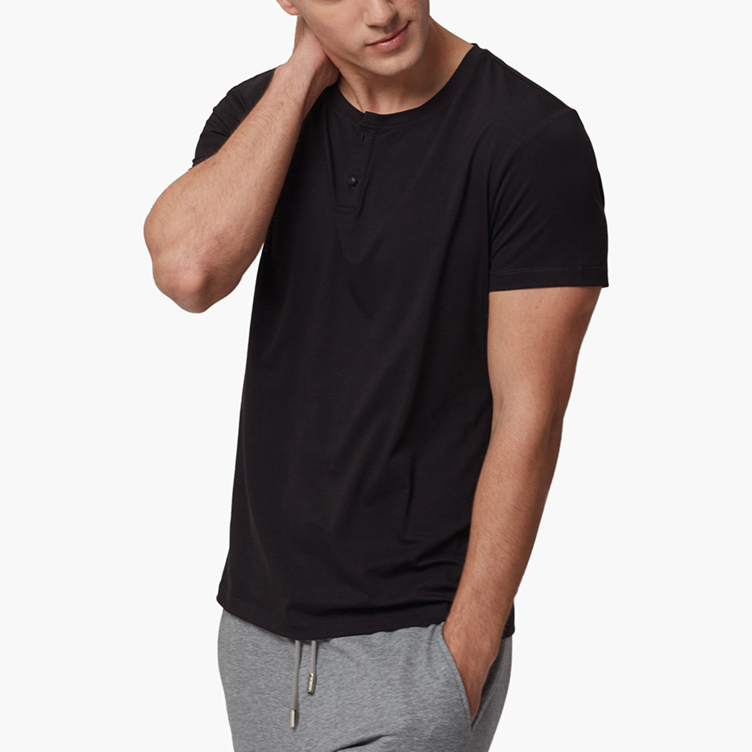 Classic short-sleeve henley in a slub fabric with a clean hem and logo jock tag. Imported.