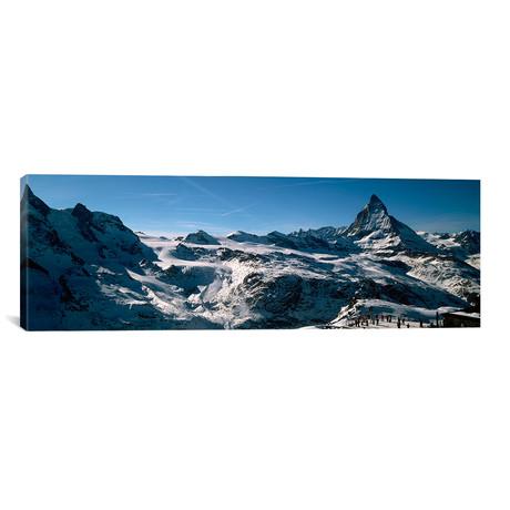 "Skiers on Mountains in Winter, Matterhorn, Switzerland (36""W x 12""H x 0.75""D)"