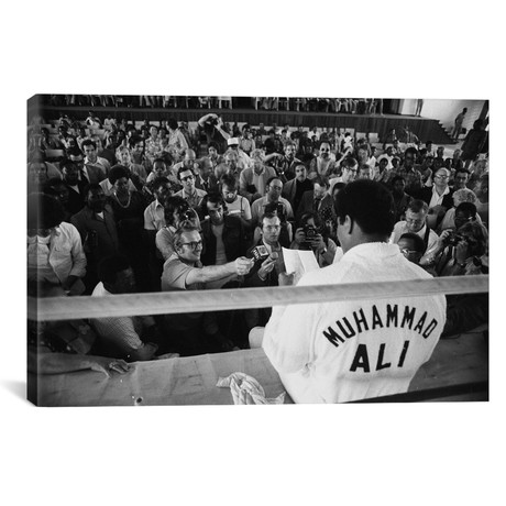 "Muhammad Ali Sitting On The Side Of A Ring Talking To The Press // Muhammad Ali Enterprises (26""W x 18""H x 0.75""D)"