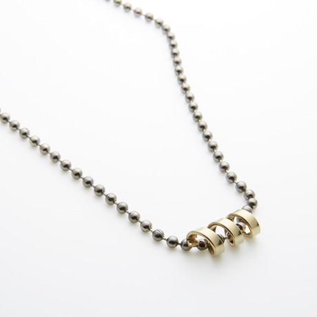 Gold Spiral Charm + Gunmetal Chain