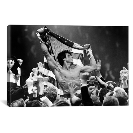 "Sylvester Stallone Carried By A Men And Holding A Flag (18""W x 26""H x 0.75""D)"