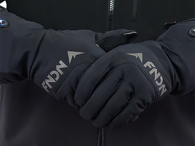 The 7V Heated Windblocker Gloves for those that demand all of the heat and none of the bulk. The new slim-line battery pack allows for a smaller footprint and a reduced size, while the 3-level power setting controller makes it simple to control the temperature. The technical wind-blocking thin shell material is stretchy enough for maximum dexterity and works with touchscreen devices.It's all possible thanks to the FNDN stainless threading heat element, which provinces even heating throughout the material with superior durability. Simply plug the lightweight rechargeable lithium batteries into the gloves and slip them into the pockets located in the wrist. Press and hold the power button for 3 seconds and you'll instantly feel heat inside the glove. Complete with a zippered carrying case, these comfortable and stylish gloves are the perfect way to stay warm throughout the day.