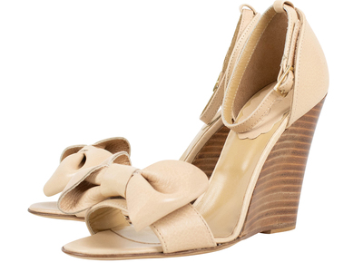 Photo of The Designer Shoe Collection Valentino, Ferragamo + More Red Valentino // Bow Ankle Strap Wedge Heels // Beige (Euro: 36.5) by Touch Of Modern