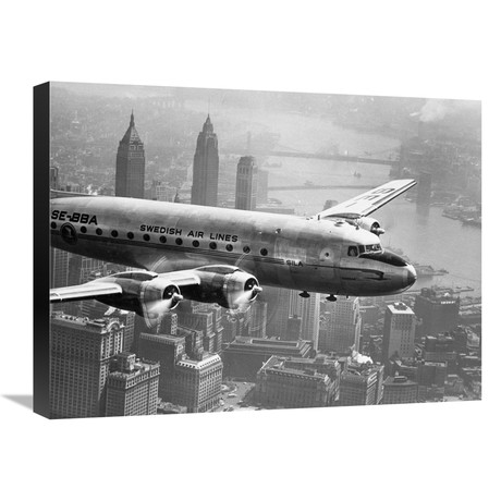 """Aircraft Flying Over City, 1946 (24""""W x 18""""H x 1.5""""D)"""