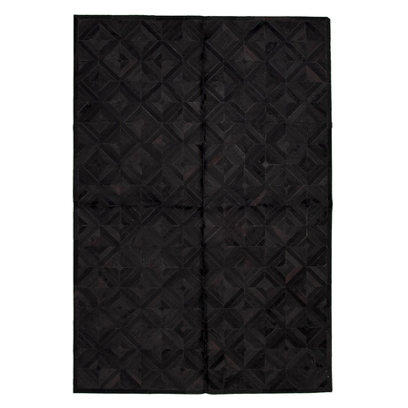 Cowhide Patchwork // Black // 6'W x 9'L