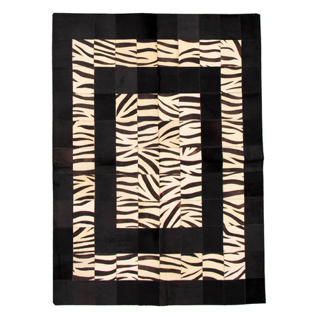Cowhide Patchwork // Black + Cream // 5'W x 7'L