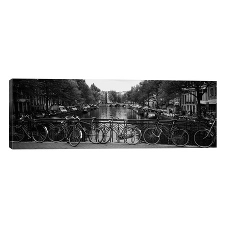 """Bicycle Leaning Against A Metal Railing On A Bridge, Amsterdam, Netherlands // Panoramic Images (60""""W x 20""""H x 0.75""""D)"""