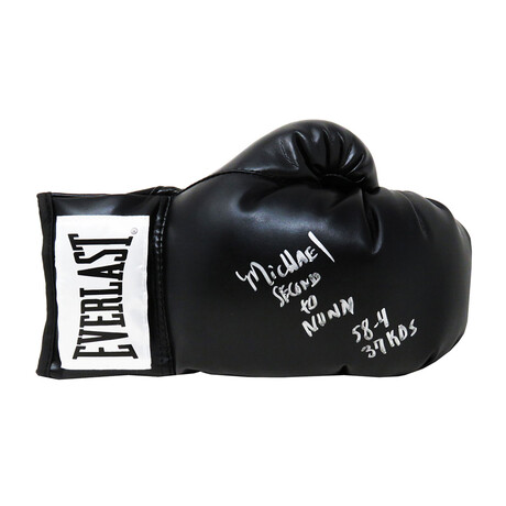 "Michael Nunn // Signed Everlast Boxing Glove // Black // ""Second To Nunn"" + ""58-4, 37 KO's"" Inscriptions"
