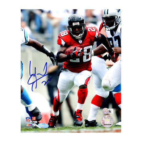 Warrick Dunn // Signed Atlanta Falcons Action 8x10 Photo // Steiner Authenticated